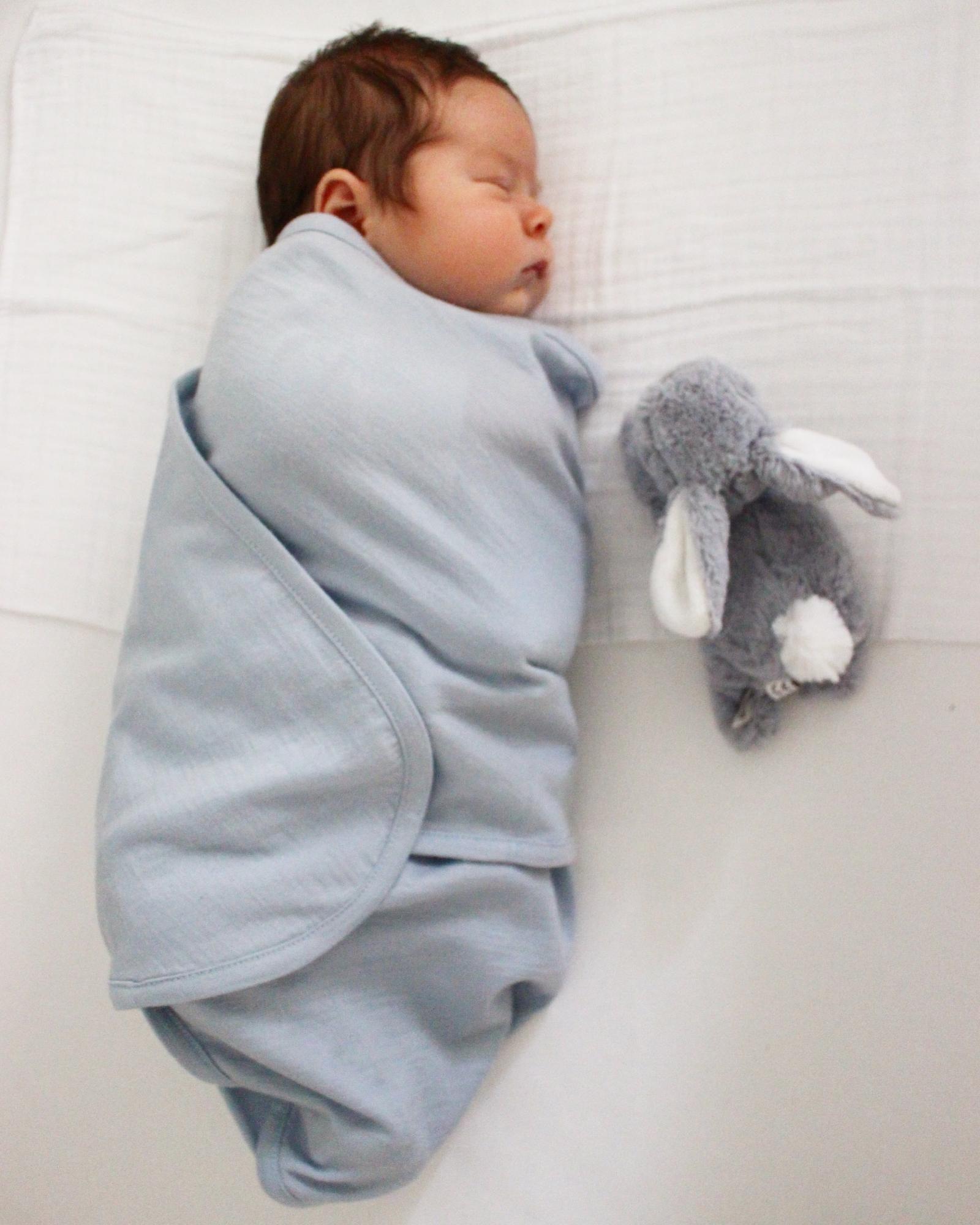 Swaddling to encourage sleep
