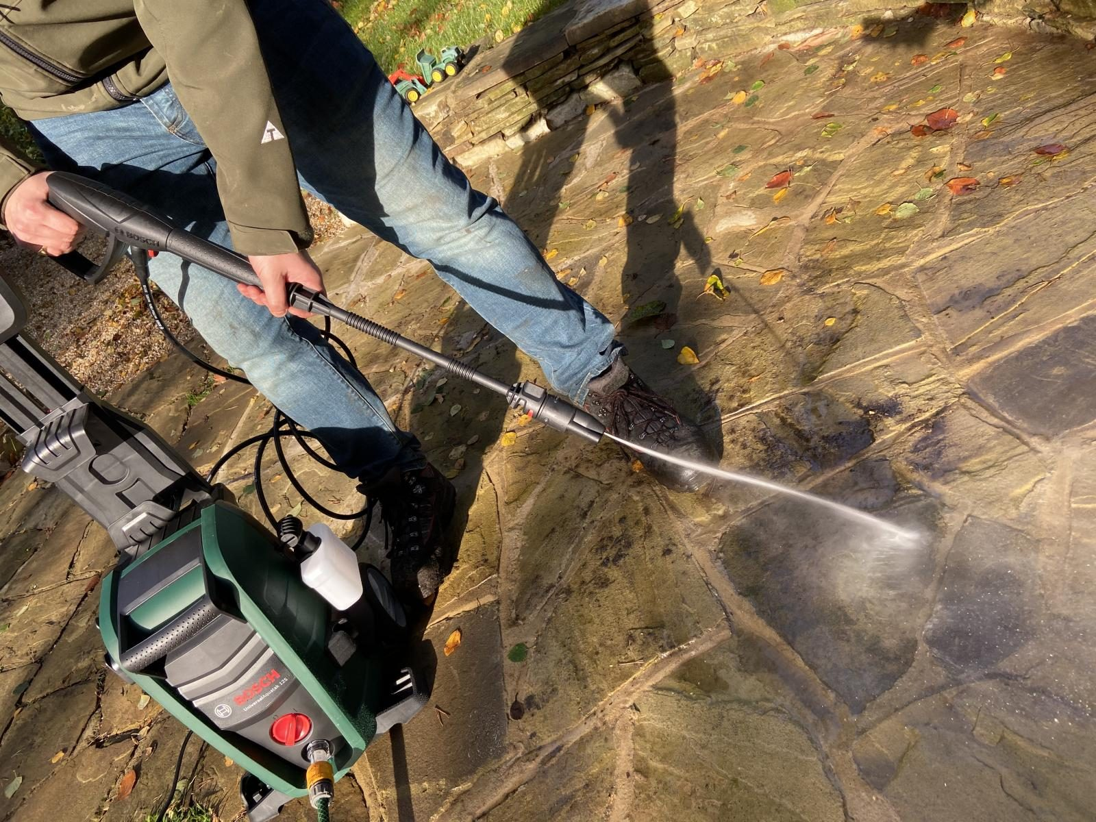 Power washing the patio with the Bosch UniversalAquatak 125 pressure washer